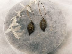 I love all of the texture of these hammered blackened brass leaf earrings. Leaf Earrings, Brass, Pendant Necklace, Texture, My Love, Modern, Jewelry, Design, Surface Finish