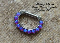 Teal opal septum clicker made by Industrial Strength.