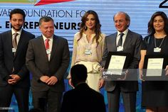 Jordan's King Abdullah II , Jordan's Queen Rania and crown prince Hussein stand on stage with representatives of associations who were awarded Social Entrepreneur of the Year by the Schwab Foundation on the opening day of the World Economic Forum on the Middle East and North Africa 2015 on May 22, 2015 in the Dead Sea resort of Shuneh, west of the capital Jordanian Amman. Maysoun Odeh Gangat, a Palestinian social entrepreneur who launched NISAA Radio Broadcasting Company; Pierre Issa…