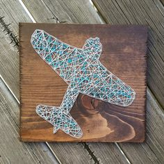 Custom string art airplane sign by Blossomingburlap on etsy