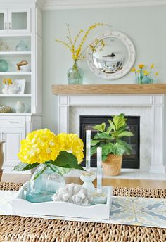 Spring Family Room and Kitchen Tour. Spring Family Room and Kitchen Tour. Take a spring family room and kitchen tour all decked out in soft shades of blue and pops of cheerful yellow and lush botanicals. Yellow Family Rooms, Coastal Family Rooms, Fall Living Room, Living Room Kitchen, Living Room Decor, Family Kitchen, Living Rooms, Sisal, Blue And White Wallpaper