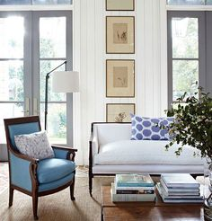 Love the doors, the white walls, the furniture!