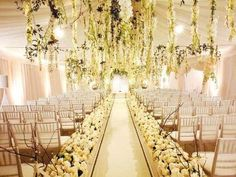 cream and white wedding ceremony  cascading florals + rose-studded aisle