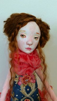 https://flic.kr/p/pHLTAE   Amée   Amée is a one of a kind art doll made of paperclay over a wire and foam armature.  She is dressed in many shades of pinks in honor of her favorite roses and blue for nobility. She is decorated with swarovski crystals, hand dyed silk chiffon, tulle and her hair is dyed tibetan lambs wool. Amée stands 18.25 inches tall without her base and approx. 20 inches with base.  Amée will arrive with a one of a kind certificate as well.