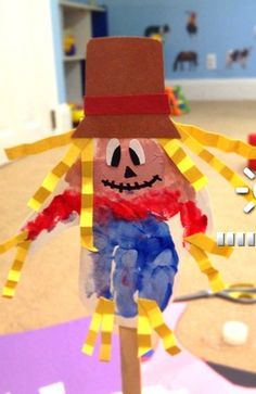 Learn how to make a scarecrow handprint craft for kids! All you need is paint, easter straw, paper, and glue!