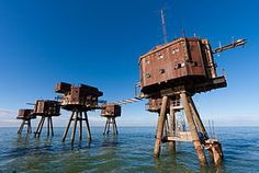 Maunsell sea forts in The Thames Estuary. Picture is? fortified towers made of concrete on what look like metal legs. Decommissioned in the late 1950 - sighted at or near Whitstable at a place called Rough Sands ..see Wikipedia..hmmm
