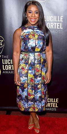 Last Night's Look: Love It or Leave It? | UZO ADUBA | in a tropical floral-print high-neck Suno dress, red lip and matching shoes at the Lucille Lortel Awards in N.Y.C.