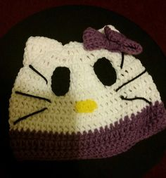 Teen / Small Adult Hello Kitty Inspired Beanie with Purple Trim and Bow Pick up one of your very own today www.etsy.com/shop/ALMBandJHANDMADE