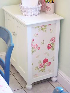 Wallpapered cabinet by Elyse Major 20 Incredible Furniture Makeovers
