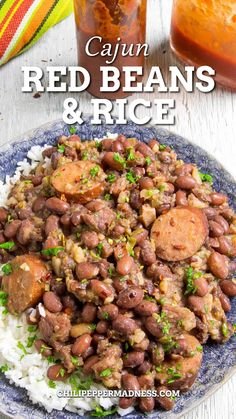 This Red Beans and Rice recipe is classic Cajun comfort food, with perfectly spiced beans simmered slowly in a pot with smoked andouille sausage, onions, bell peppers and celery, served up with rice for surprisingly complex flavor. #redbeans #rice #cajunrecipe #cajun #ricerecipe | chilipeppermadness.com @chilipeppermadness Spicy Chicken Recipes, Easy Rice Recipes, Cajun Recipes, Bean Recipes, Lunch Recipes, Jalapeno Recipes, Cajun Food, Cooking Recipes, Red Beans And Rice Recipe Crockpot