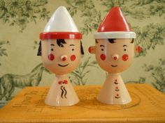 Plastic Salt and Pepper Shakers - Boy and Girl Heads With Red and White Hats.