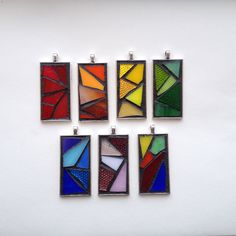 """Gorgeous colorful abstract stained glass mosaic pendants. Silver-plated base with 18"""" waxed cotton cord. Hand created by NiagaraGlassMosaics on Etsy"""