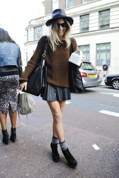 long, baggy sweater w/ short, pleated skirt.  the greys in the hat, skirt & socks tie it all together.