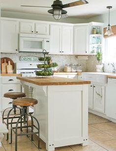 Love the bar stools in this white kitchen. And the butcher block island! #whitekitchen #butcherblockisland