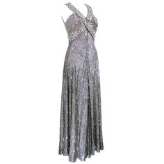 70s Silver Lurex Glitter Gown  Encrusted with Iridescent Paillettes and Gems | From a collection of rare vintage evening dresses and gowns at https://www.1stdibs.com/fashion/clothing/evening-dresses/
