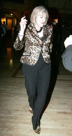 She hits the dancefloor in a shiny leopard print blazer and matching shoes Teresa May, Boys Are Stupid, Prime Minister, Celebs, Celebrities, Grey Pants, New Day, Amazing Women, Style Icons