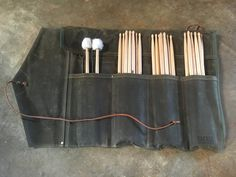 http://tackleinstrument.com/collections/all/products/waxed-canvas-stick-roll-up-bag
