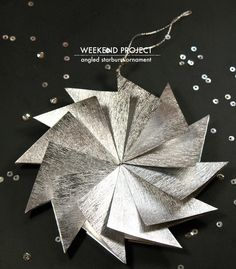 How to make this DIY Angled Starburst Ornament | Poppytalk: Weekend Project | This is a simple, modern paper ornament that is easy to make and looks great on the tree. Being lightweight, it twirls when hung, reflecting light from its many angles.