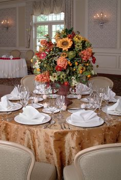 Warm fall tones with this beautiful wedding centerpiece