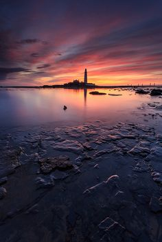 ~~A blaze of colour ~ sunrise, the tide recedes to uncover interesting rocks, clouds in their pink and red glory, St Mary's Lighthouse, Whitley Bay, North Sea, England by images through a lens~~