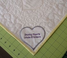 I like the idea of the heart shaped label in a corner of the quilt.