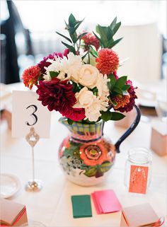 Could use the pitchers to hold the flowers and frames to hold the band names. Vintage and rock at the same time!