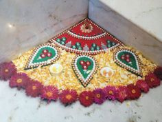 Corner Rangoli… Corners are the most avoided lot in home or office so highlight them with Corner Rangoli…The purpose of rangoli is decoration, and it is thought to bring good luck… decorate it with Diyas and Flowers for enhanced design…