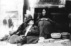 Indian family selling baskets in downtown Seattle, ca. 1912, UW Library American Indians of the Pacific Northwest Collection