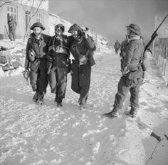 """Operation Archery"" Vågsøy and Måløy raid, Norway. 27 December Commando Lieutenant Denis O'Flaherty being helped through the snow to a dressing station. The Commando on the right with a fixed bayonet is Commando Derek Gordon Page. History Major, Germany And Italy, Island 2, Army & Navy, British Army, Great Britain, World War Ii, Wwii, Norway"