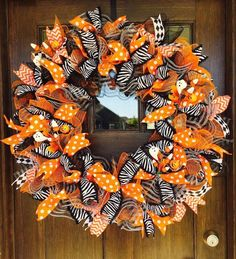 How to Make a Halloween Mesh Ribbon Wreath (Video) Make your own version of Halloween mesh ribbon wreath with our tutorial. Adorn your home with this wreath to bring a Halloween punch. Fall Ribbon Wreath, Ribbon Wreath Tutorial, Mesh Ribbon Wreaths, Burlap Wreaths, Door Wreaths, Tulle Wreath, Floral Wreaths, Halloween Mesh Wreaths, Christmas Mesh Wreaths
