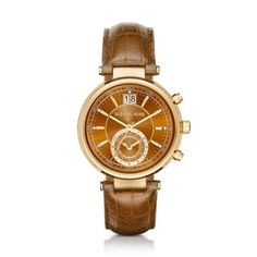 Michael Kors Brown Sawyer Watch The gold-tone Michael Kors Sawyer watch features a unique chronograph movement and date window on its amber sunray dial and sophisticated amber leather straps for a bold, one-of-a-kind look.