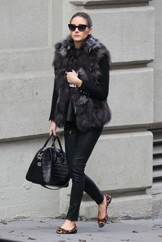 Spotted out taking care of her day, Olivia Palermo is spotted rocking a fur vest, leopard print flats, and a pair of Paige Denim Edgemont Ultra Skinny Jeans in Black Silk....