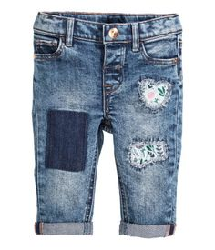 SO cute! $29 5-pocket jeans in washed stretch denim with appliqués front and back. Distressed details, adjustable elasticized waistband, and fly with snap fastener.