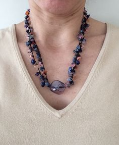 Lovely glass purple bead. Adorable colors... $20 https://www.etsy.com/listing/213679355/stone-necklace-with-colorful-stones-and?ref=shop_home_feat_2