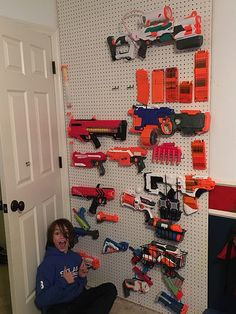 nerf gun wall storage pegboard for guns gun peg board wall pegboard for guns gun. : nerf gun wall storage pegboard for guns gun peg board wall pegboard for guns gun storage how to build a nerf gun storage wall Kids Storage, Storage Design, Wall Storage, Toy Storage, Pegboard Storage, Paper Storage, Craft Storage, Peg Board Walls, Peg Boards