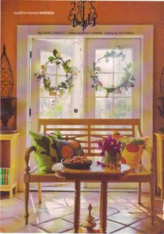 The lemon wreaths on the french doors and the fruit pillows from American Dream Cottages