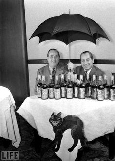 Anti-Superstition Society, 1940 Chicago - Opening an umbrella indoors and black cats