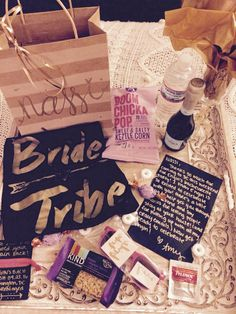 Bachelorette Welcome Bag  :) Wine Glass, Champagne, Bottle of water, snacks, sunglasses, hair tie & matching bridesmaids shirts.