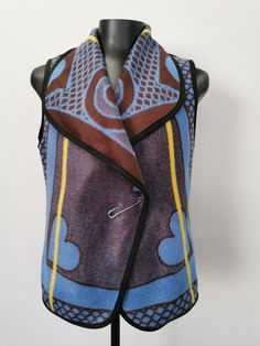 Blue Basotho Blanket Waistcoat with shawl collar fastened with the traditional blanket pin called phini Body Warmer, Shawl, Vest, Backpacks, Fashion Outfits, Blue, Fashion Suits, Backpack