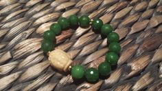 Faceted Emerald and Carved Jade Buddha beaded by artifaKsJewelry