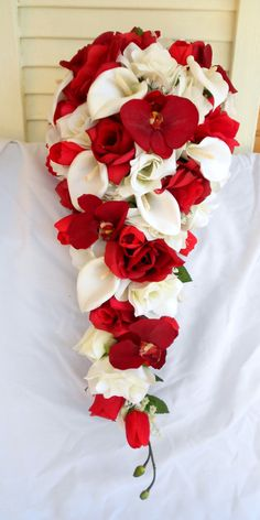 Red orchids silk cascade bouquet with ivory roses and calla lilies by VictoriaSilkDesigns on Etsy https://www.etsy.com/listing/233308504/red-orchids-silk-cascade-bouquet-with