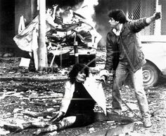 A rescue worker pulls a wounded woman from the wreckage caused by a massive bomb explosion, in Beirut, Lebanon, Feb. 5, 1983, outside the building housing the Palestine Research Center and the Libyan news agency. At least eight were killed and more than 50 wounded. Scores of people were trapped in the burning building. (AP Photo/Staff/Saade)