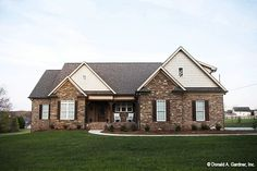 Siding and stone detailing add Craftsman charm to this inviting ranch-style house plan. This four bedroom house plan with a large kitchen and open great room. Brick Ranch House Plans, Ranch Style Floor Plans, Brick Ranch Houses, Basement House Plans, Country Style House Plans, Craftsman Style House Plans, Modern House Plans, House Floor Plans, Farmhouse Style