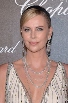 Charlize Theron in Prada attends the Chopard Trophy photocall the 70th Annual Cannes Film Festival