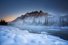 Castle Mountain, Banff National Park - The iconic Castle Mountain behind an icy cold Bow River in Banff National Park, Alberta.