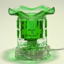 Emerald electric oil warmer. Our series of electric glass oil burners, are super fun and easy and, go great with any décor. This oil burner puts off a soft aromatic scent and doubles as a nightlight. The fragrance burner comes with a dimmer switch which allows you to control the intensity of your fragrance. Adjust the dimmer up for more fragrance or, down for less fragrance. The oil burner comes with a removable oil dish for easy clean up and a 35 watt halogen bulb. $13.00 www.jenascents.com