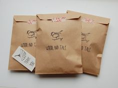 Stamped bags sealed with washi tape #etsypackaging