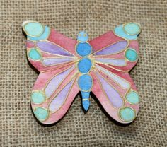 This is our 6mm butterfly shape, decorated with watercolours and gold glass paint outliner.