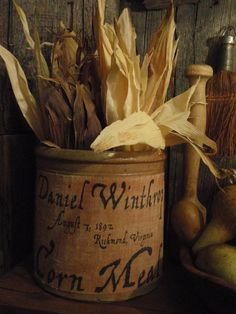 Love the simplicity of corn shucks in a crock to add to an autumn vignette!!