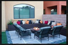 backyard patio with square tiles ceramic fire pit bowl pillows outdoor space for entertaining